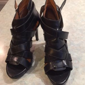 Michael Kors black strappy sandals.